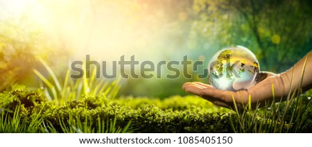 Glass globe in hand,concept for environment. #1085405150