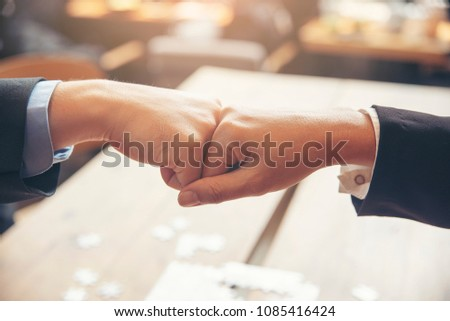 Business Teamwork giving first bump hand after success deal and complete agreement.Professional Businessman and Partnership meeting in office.Teamwork and Partnership concept. #1085416424