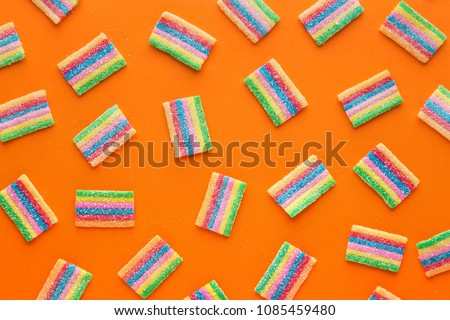 Colorful gummy candies pattern on a orange background. Soft gums viewed from above. Variation concept. Gay colors. Top view #1085459480