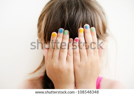 Little girl with her hands covering her eyes, see no evil #108548348
