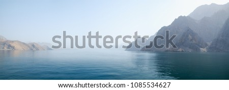 Sea tropical landscape with mountains and fjords, Oman. Vacation holiday recreation travel concept.  #1085534627