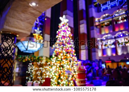 new years tree decorations with a big star on top of it standing at cruise liner lobby #1085575178
