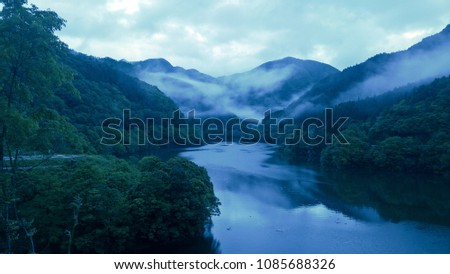 A quiet lake with mist #1085688326