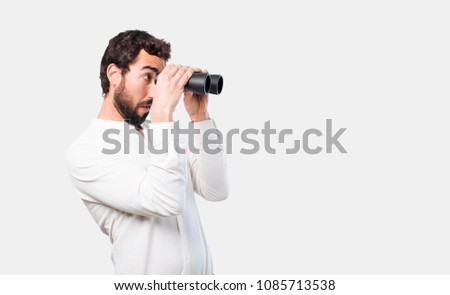 young crazy or mad man, expressive face with a binoculars #1085713538