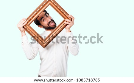 young crazy or mad man, expressive face with a baroque frame