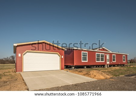 New manufactured home and stick built garage need finishing before owners can move in #1085771966