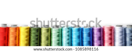 Color sewing threads on white background, top view #1085898116