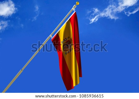 Spain flag Silk waving flag with emblem of  Kingdom of Spain with a flagpole on a sunny blue sky background with white clouds  3D illustration