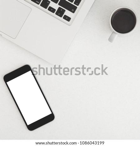 Mobile phone, coffee and keyboard. Minimal workspace. #1086043199