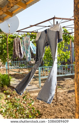 clean clothes, after washing on a rope #1086089609