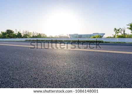 empty asphalt road with city skyline #1086148001