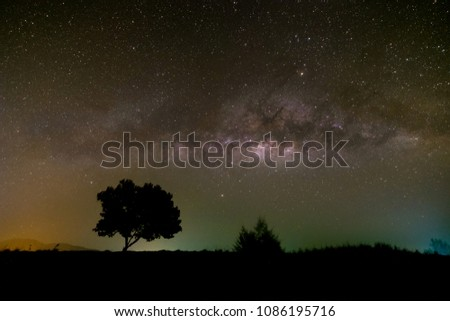 Milky way galaxy brightening in the night sky over the mountain. #1086195716