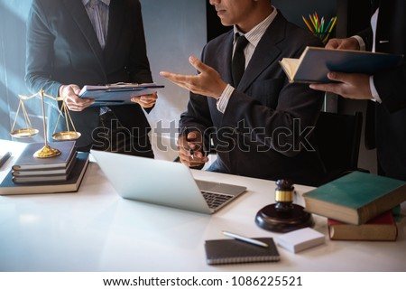 Lawyers having team meeting with law documents and negotiating contact in office. justice and law ,attorney, court judge, concept. #1086225521