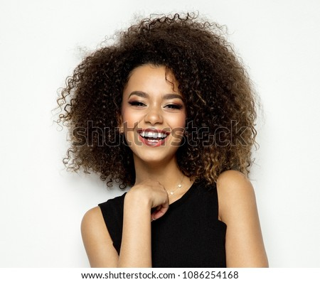 Beautiful black female model smiling #1086254168