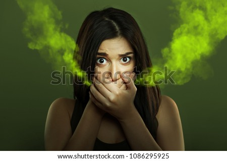 Halitosis concept of woman with bad breath Royalty-Free Stock Photo #1086295925
