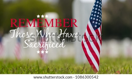 Small American flags and headstones at National cemetary- Memorial Day display - with copy #1086300542
