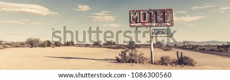 A dilapidated, classic, vintage motel sign in the desert of Arizona #1086300560
