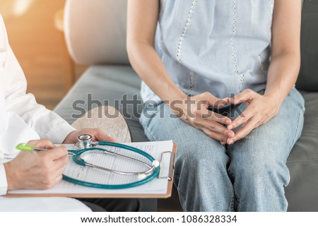 Doctor or psychiatrist consulting and diagnostic examining stressful woman patient on obstetric - gynecological female illness, or mental health in medical clinic or hospital healthcare service center #1086328334