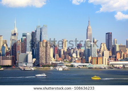 Manhattan Skyline with Empire State Building over Hudson River, New York City