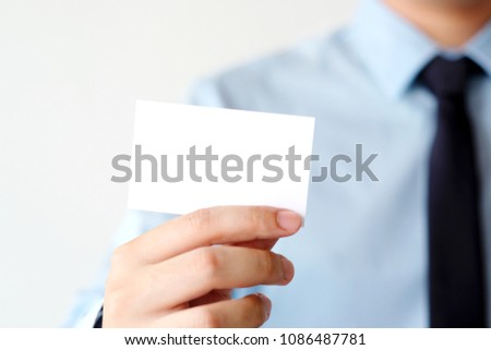 Businessman hand holding blank white business card with copy space for text, business mock up background concept  #1086487781