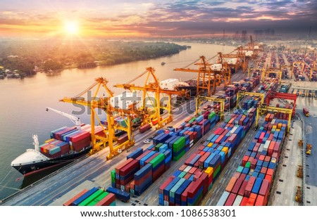 Logistics and transportation of Container Cargo ship and Cargo plane with working crane bridge in shipyard at sunrise, logistic import export and transport industry background #1086538301