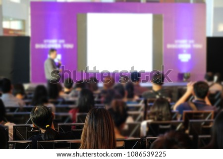 Audience listening speaker who standing in front of the room at the conference hall, Business and Entrepreneurship concept. #1086539225