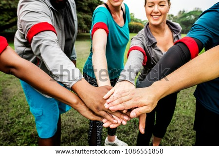 Diverse team stacking their hands #1086551858
