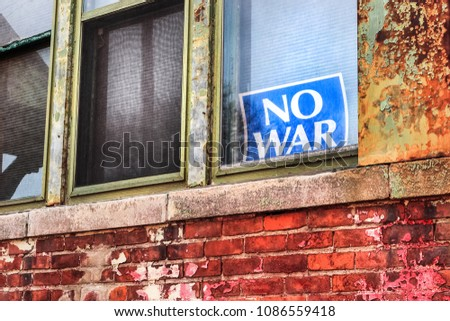 "Sign in a window saying ""no war"""