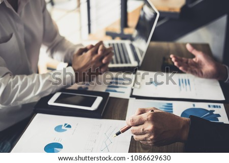 Business people are working in office, presentation in front of boss, businessman leader presentation to colleagues and business strategy and pointing to the graph and chart. #1086629630
