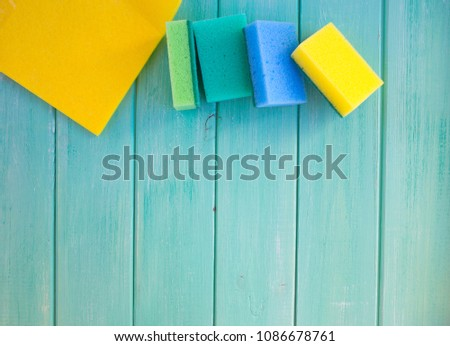 sponges for washing dishes on a wooden background #1086678761