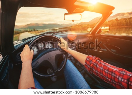 Driver hands on the wheel #1086679988