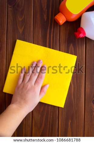 Cleaning with a dust cloth #1086681788