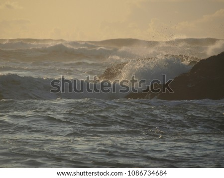 Ocean waves rolling towards the shore, crashing over rocks, splashing a salty mist creating foamy surf, Northern California Coast, USA. #1086734684