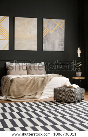 Retro bedroom interior with paintings, bed, blanket, cushions, carpet, pouf, book and lamp #1086738011