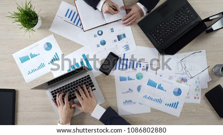 Analysts studying opinion poll statistics, preparing election campaign strategy #1086802880