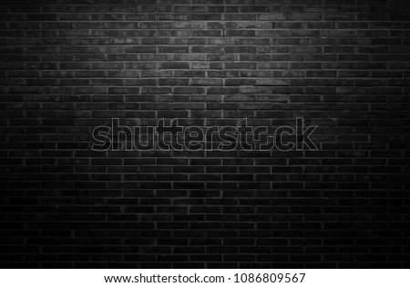 Black wall background The surface of the brick dark jagged. Abstract black wall background #1086809567