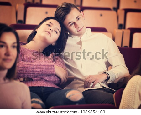 Young couple watching movie at date in cinema house #1086856109