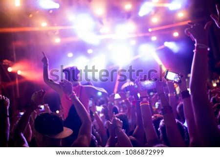 Portrait of happy crowd enjoying at music festival #1086872999