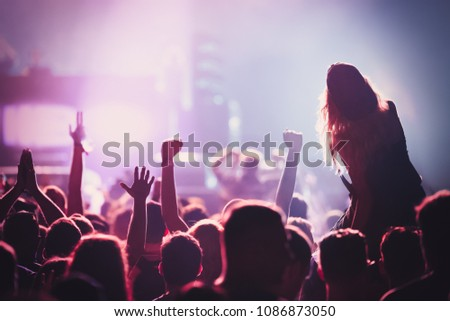 Picture of dancing crowd at music festival #1086873050