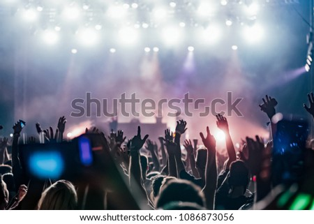 Picture of dancing crowd at music festival #1086873056