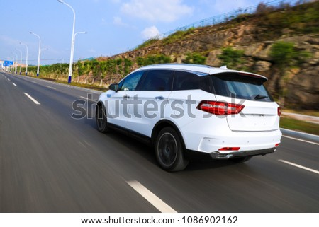 White suv flying through the national highway #1086902162