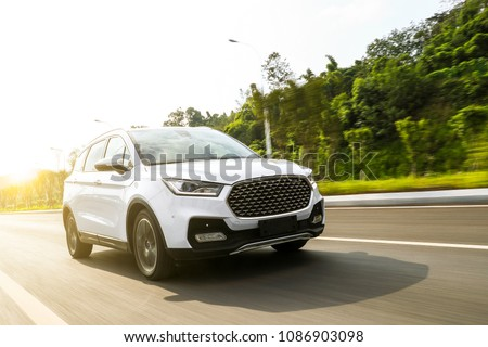 White suv speeding on fast road #1086903098