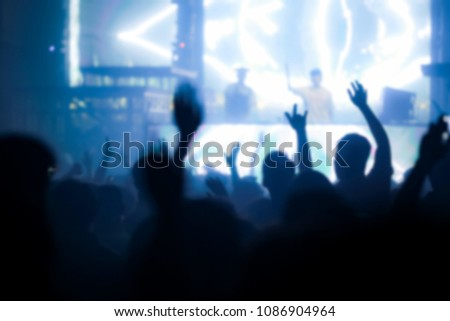 Effects blur Concert, disco dj party. People with hands up having fun  #1086904964