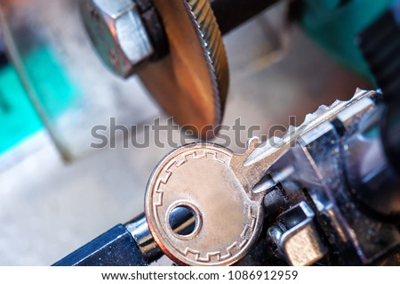locksmith, key duplication machine makes new copy #1086912959
