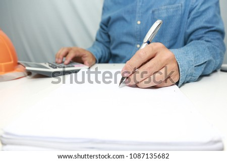 Hand man Writing tax on desk about at home office. #1087135682
