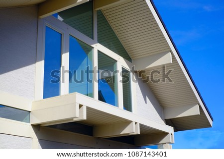 Summer landscape beautiful bright wooden house with Windows. #1087143401