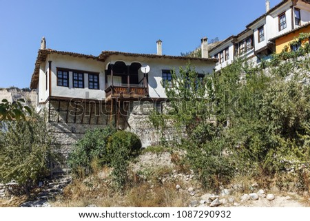 MELNIK, BULGARIA - SEPTEMBER 7, 2017:  Old houses of the nineteenth century in town of Melnik, Blagoevgrad region, Bulgaria #1087290932