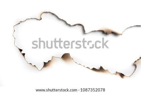 Burning paper on white paper with shadow,text copy space. #1087352078