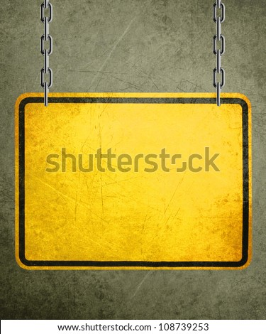 Alert yellow sign hanging by metal chain, conceptual image for under construction and coming soon