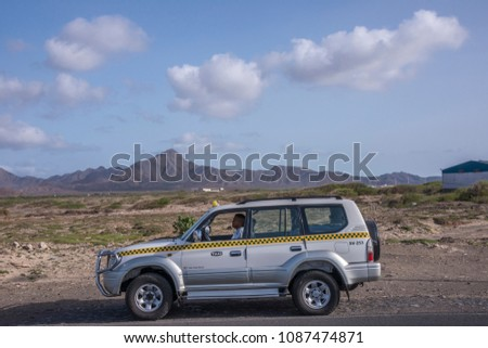 San Vicente island, Cape Verde - september 29, 2015: Taxi circulating on the road towards the city of Mindelo #1087474871